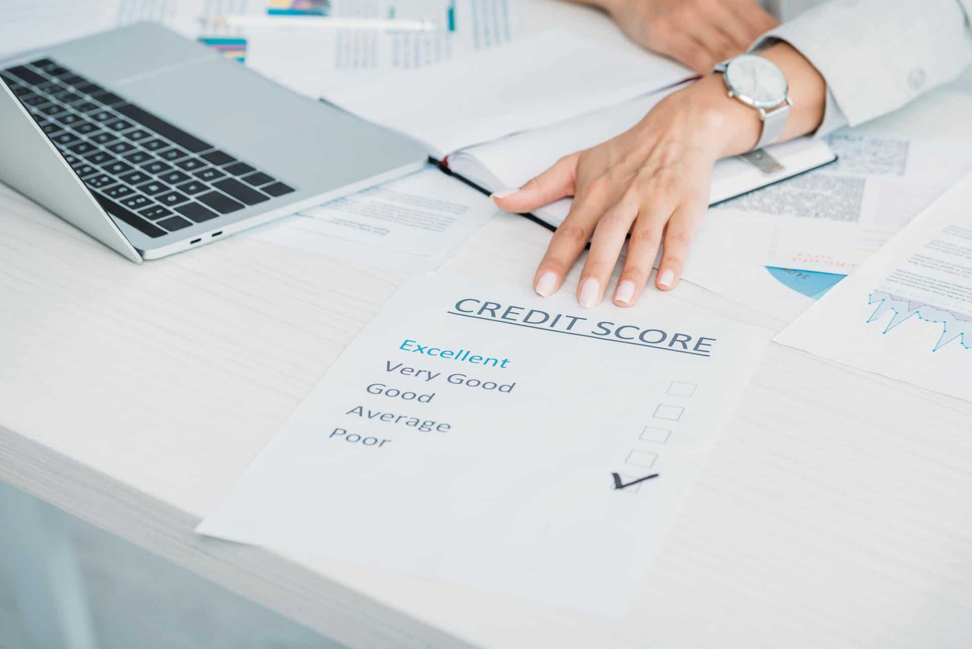 cropped view of woman showing bad credit score at office