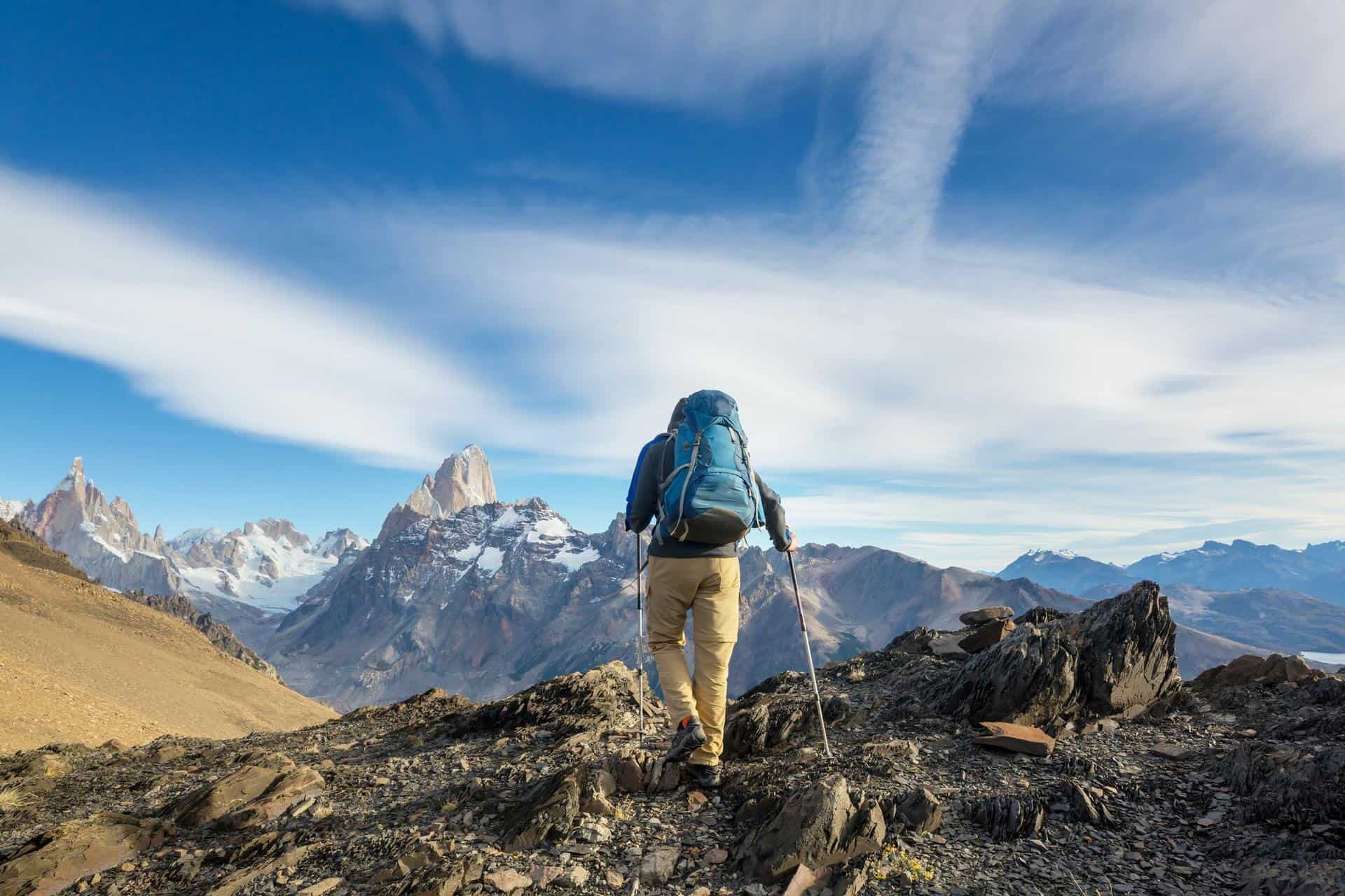 back of mountain climber climbing in Pategonia
